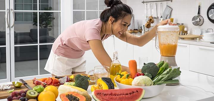 Asian Woman Making Smoothie